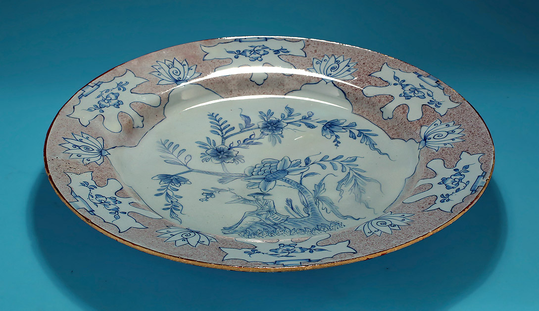 "ENGLISH DELFT MANGANESE & BLUE ""WOOLSACK"" CHARGER, probably Liverpool, c1745-55, profile showing good condition of the rim"