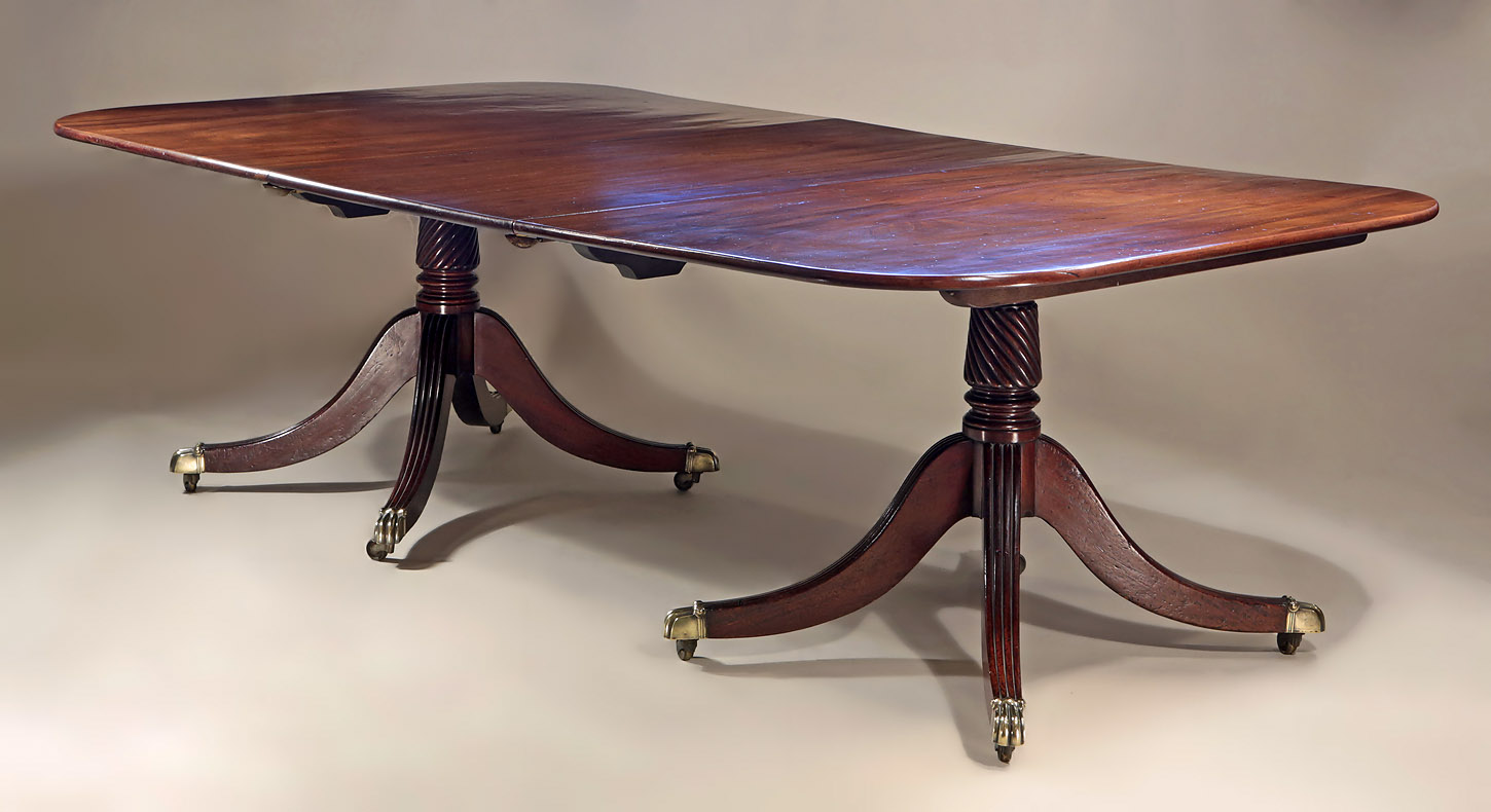Fine George III Cuban Mahogany 2-Pedestal Dining Table, shown with one leaf from on oblique angie