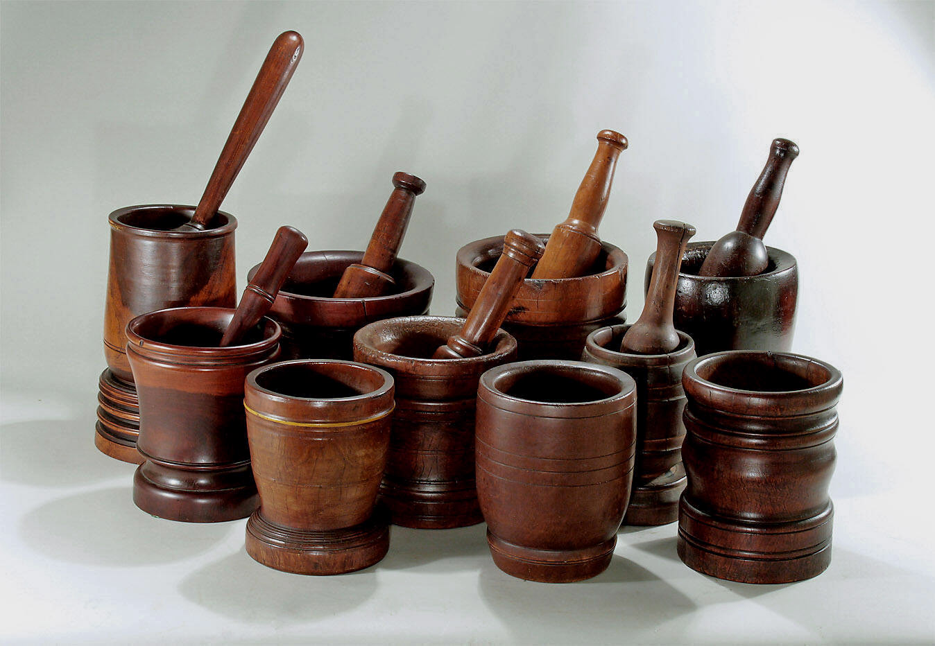 Collection of lignum vitae and fruitwood mortar pestles Motor pestle