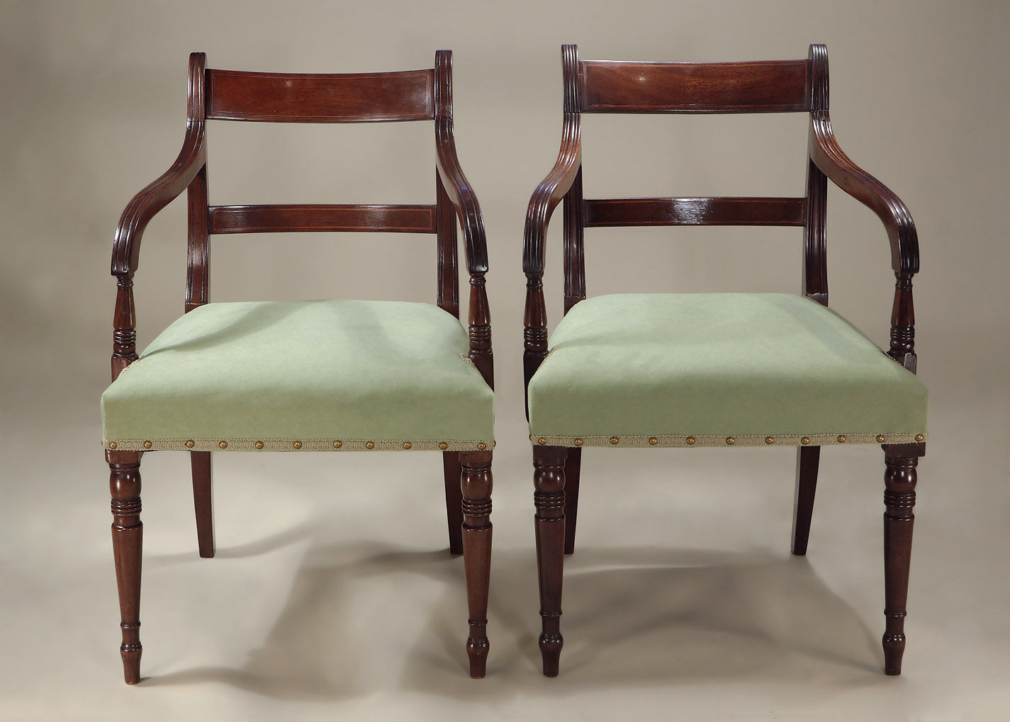 Set of 6 Late Georgian Inlaid Mahogany Sidechairs, showing the slight variance between the two armchairs