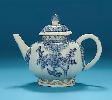 Rare Diminutive Yongzhend Blue & White Lotus-Moulded Teapot, China ,1723-35, with outset scrollwork to the base